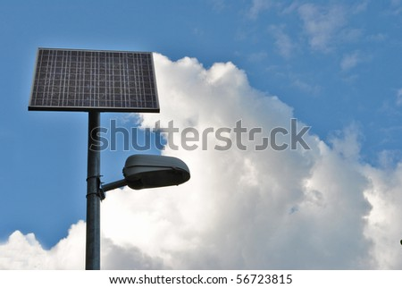 solar panels to produce electricity using the sun's rays to illuminate the mountain road