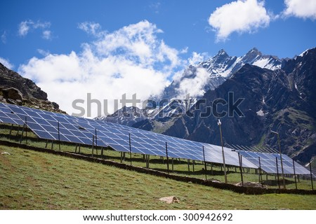 Solar panels under the blue sky with lively clouds - stock photo