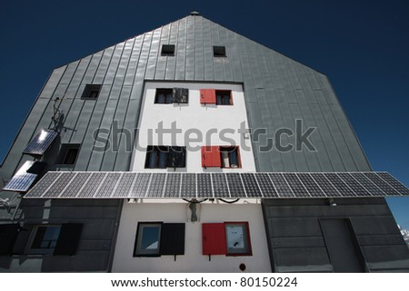 solar panels used in a refuge on the alps - stock photo