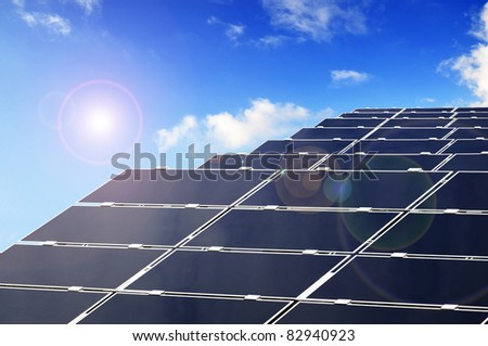 Solar Parc with Panels producing Energy by photovoltaics. - stock photo