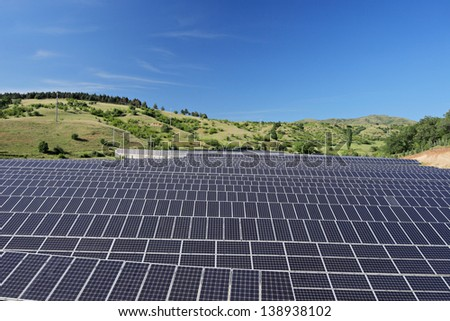 Solar photovoltaic cell panels under blue sky, Macedonia - stock photo
