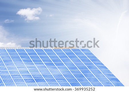 Solar photovoltaic panel on a roof with sunny background