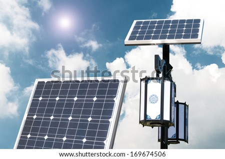 Solar photovoltaic powered lamp posts on the blue skies with sun - stock photo