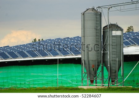 Solar power collectors installation on a farm building - stock photo