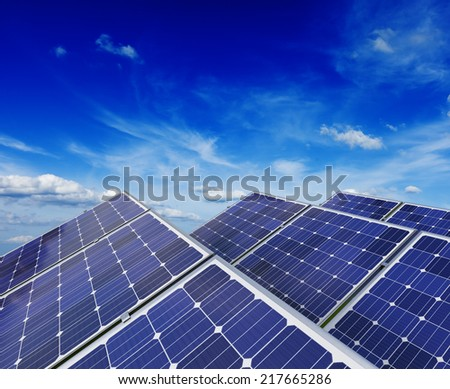 Solar power generation technology, green alternative energy and environment protection ecology business concept background - solar battery panels under blue sky - stock photo