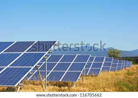 Solar power plant against a mountain landscape - stock photo