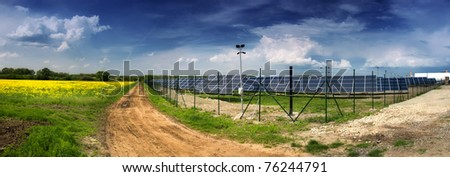 solar power plant in landscape - stock photo
