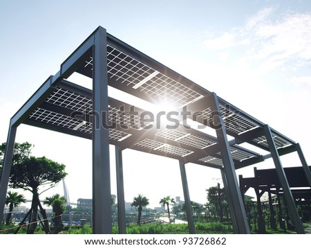 Solar power plant in park - stock photo