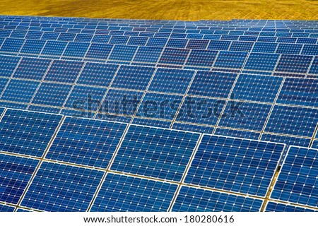 Solar power plant on the background of field - stock photo