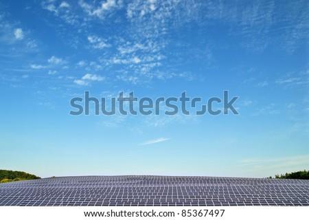 Solar power plant under blue sky - stock photo