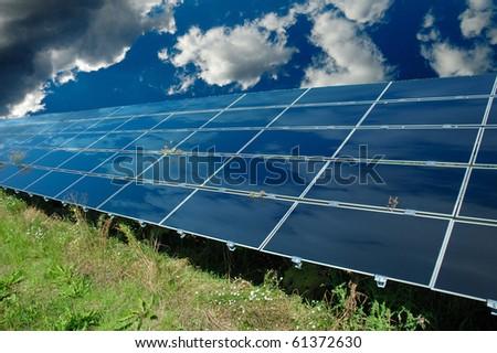 Solar power station below blue sky - stock photo