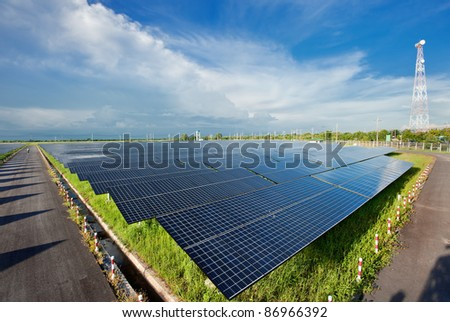 Solar power station in blue sky - stock photo