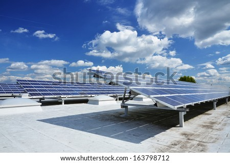 Solar power station on roof - stock photo