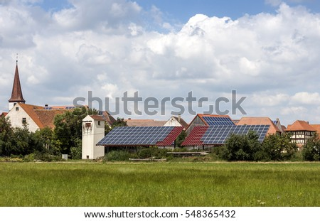 Solar powered homes in a rural village in Germany. Solar panels on roof as alternative energy source
