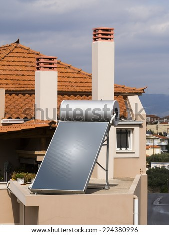 Solar water heater on roof of house - stock photo