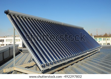 Solar water heating (SWH) systems use solar panels, called collectors, fitted to your roof. Energy efficiency concept. Solar Hot water panels heating.