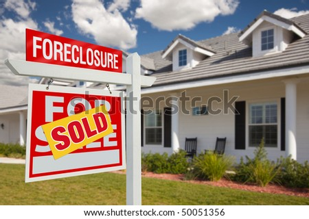 Sold Foreclosure Home For Sale Real Estate Sign in Front of New House - Left Facing. - stock photo