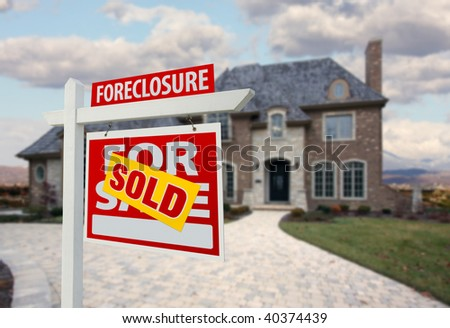 Sold Foreclosure Home For Sale Sign and House with Dramatic Sky Background. - stock photo