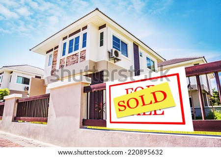 Sold Home For Sale Real Estate Sign in Front of New House.  - stock photo