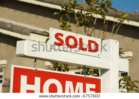 Sold Home For Sale Sign in Front of House. - stock photo