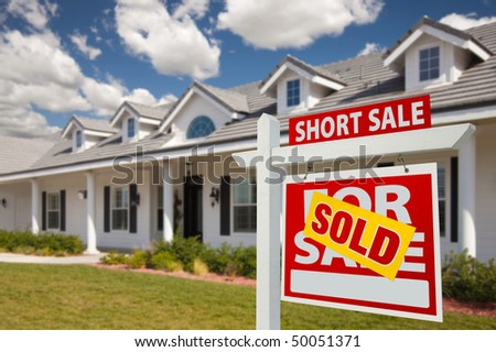 Sold Short Sale Home For Sale Real Estate Sign in Front of New House - Right Facing. - stock photo
