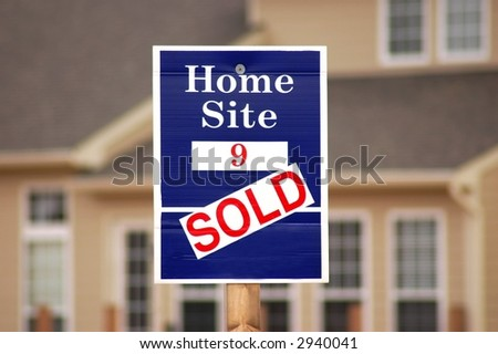 Sold sign on a residential lot - stock photo