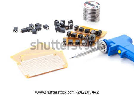 Soldering Gun Shape Placed on a white background isolated with electronic devices and consumer electronics such as audio jack and power jack female put together . - stock photo