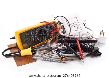 Soldering, tester, multimeter, cable outlet on a white background - stock photo