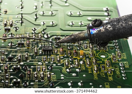 soldering tin soldering electronic board - stock photo