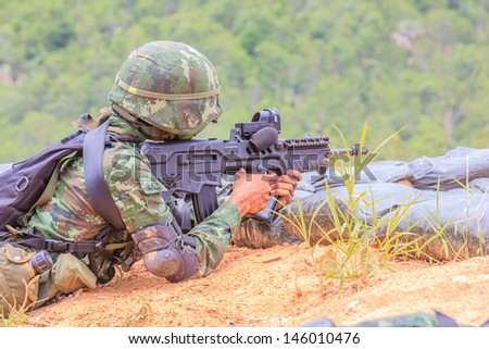 soldier aiming rifle to the target - stock photo