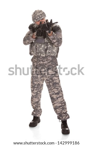Soldier Aiming With Rifle Over White Background - stock photo