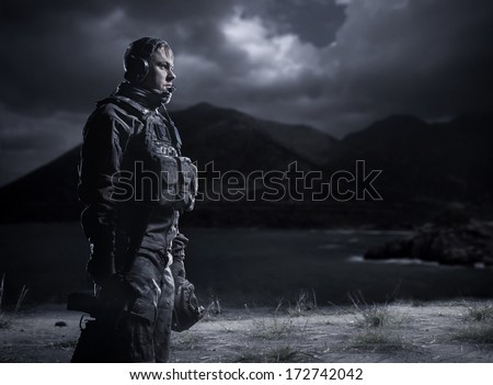 Soldier at dark. Military night under the light of the moon. Frustrated man. - stock photo
