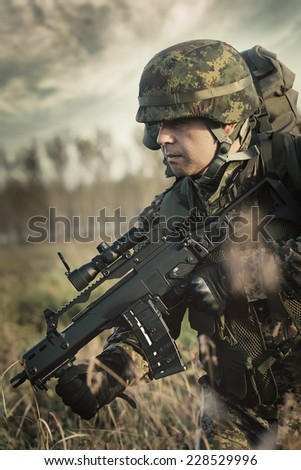 Soldier at war in the swamp - stock photo