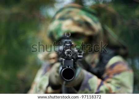 soldier carrying  M 60  in combat training - stock photo