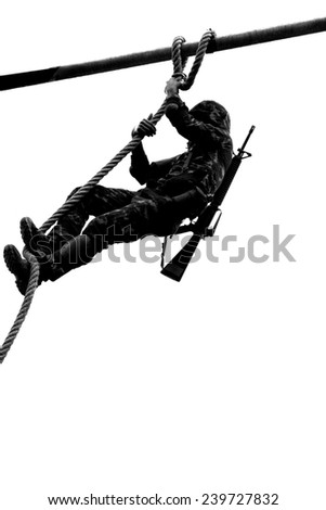 soldier climbing rope  - stock photo