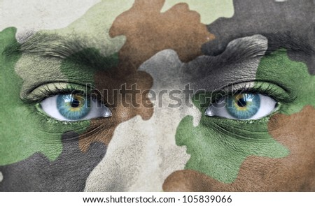 Soldier face with army colors - stock photo