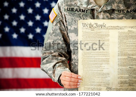 Soldier: Female Soldier Holding Constitution - stock photo