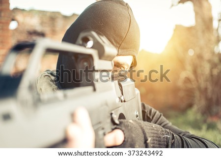 Soldier fighting on the enemy land. concept about warfare and soft air - stock photo