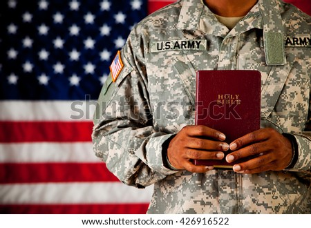Soldier: Holding a Bible in Front of Him - stock photo