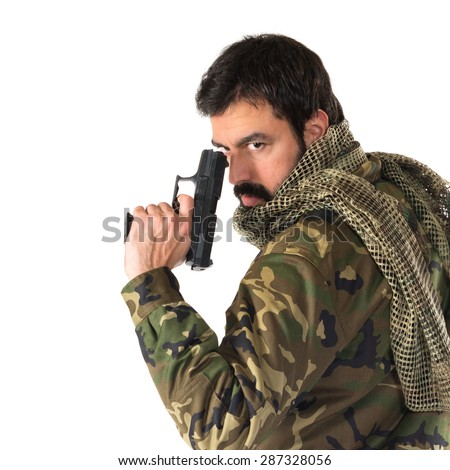 Soldier holding a gun - stock photo