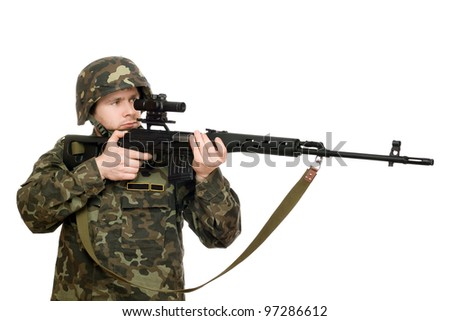 Soldier holding a rifle in studio. Isolated - stock photo