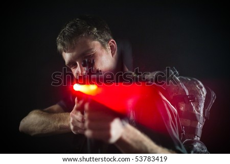 Soldier holding laser M16 rifle. - stock photo