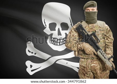 Soldier holding machine gun with flag on background - Jolly Roger - symbol of piracy - stock photo