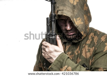 Soldier in camouflage with a gun in his hand
