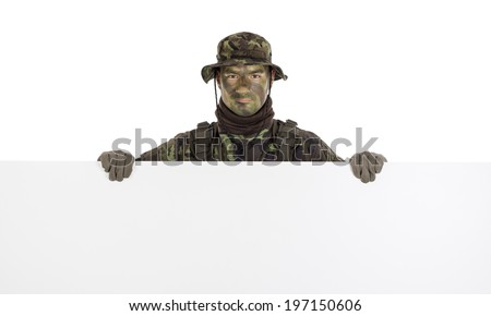 Soldier in camouflage with horizontal blank board - stock photo