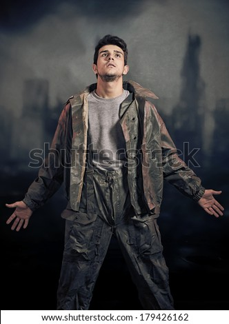 Soldier in chemical protection armor with ruins in background. After the apocalypse, final of war - stock photo
