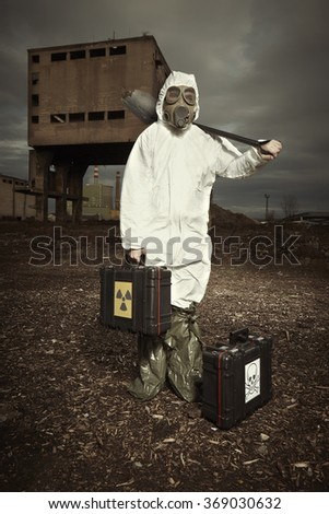 Soldier in gas mask checking environment for biological hazard - stock photo