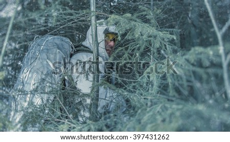 Soldier in the forest undergrowth. Scout in the woods - stock photo