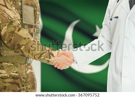 Soldier in uniform and doctor shaking hands with national flag on background - Pakistan - stock photo