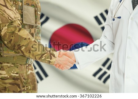 Soldier in uniform and doctor shaking hands with national flag on background - South Korea - stock photo